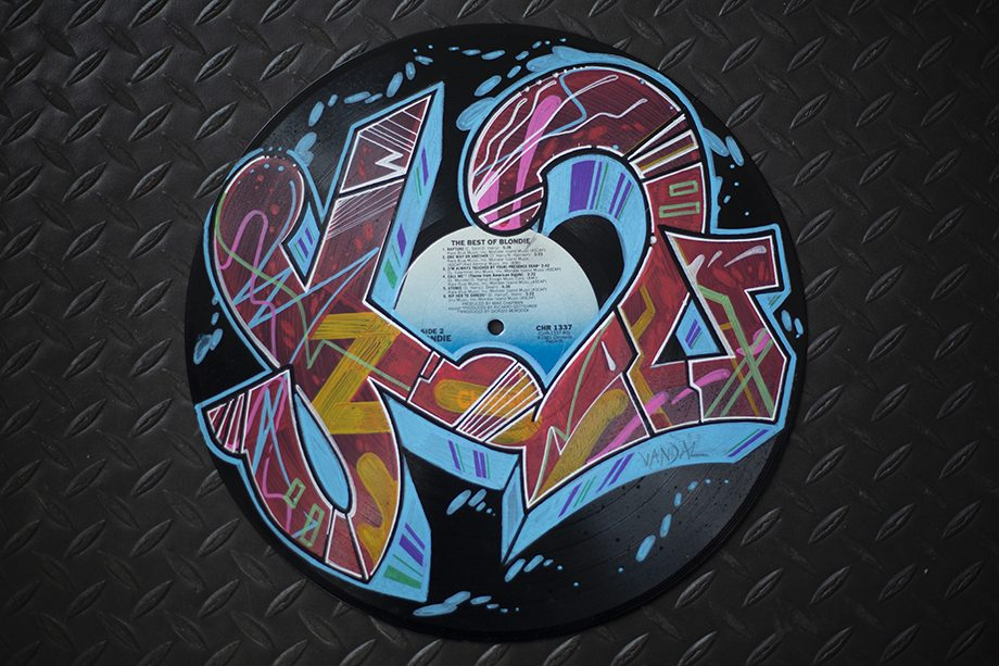 K2 hand lettering on vinyl record by vandalnyc